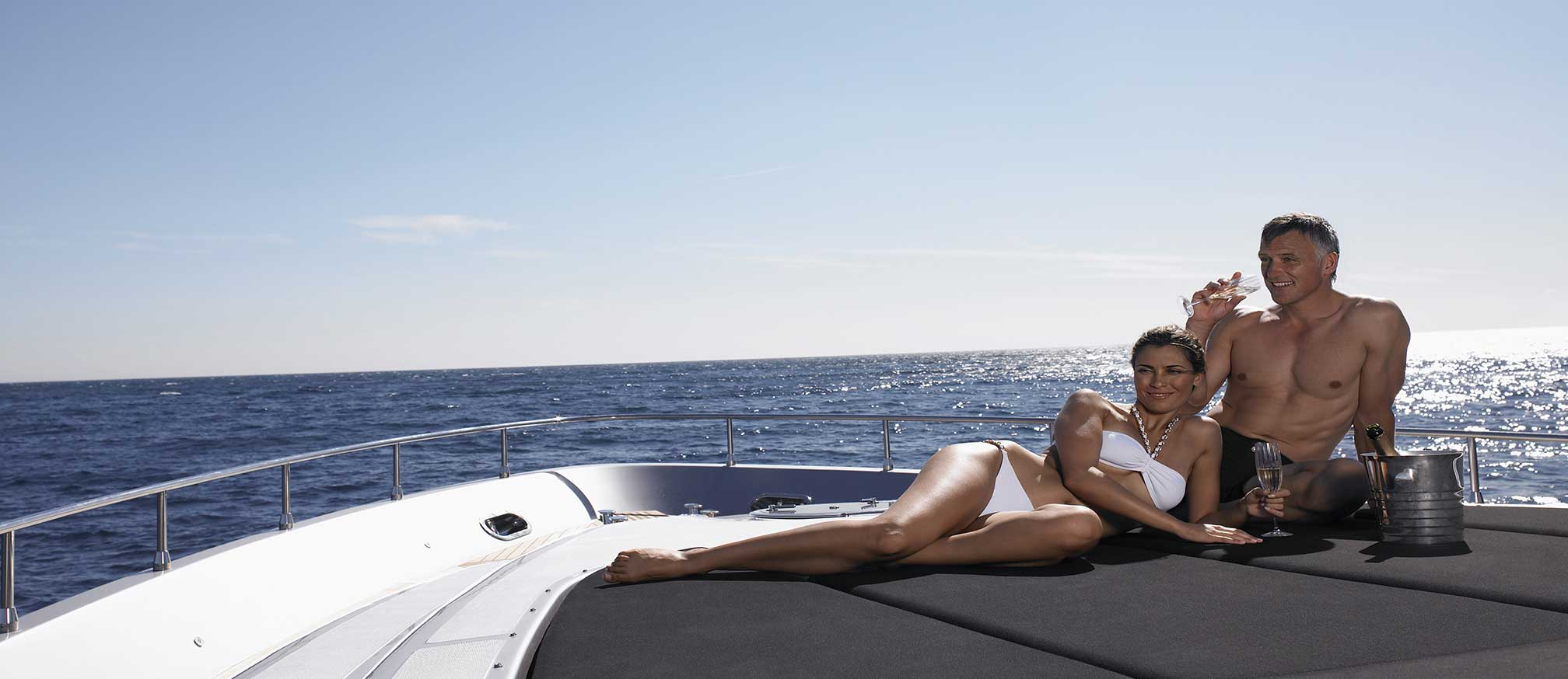 Charter luxury yacht with couple relaxing