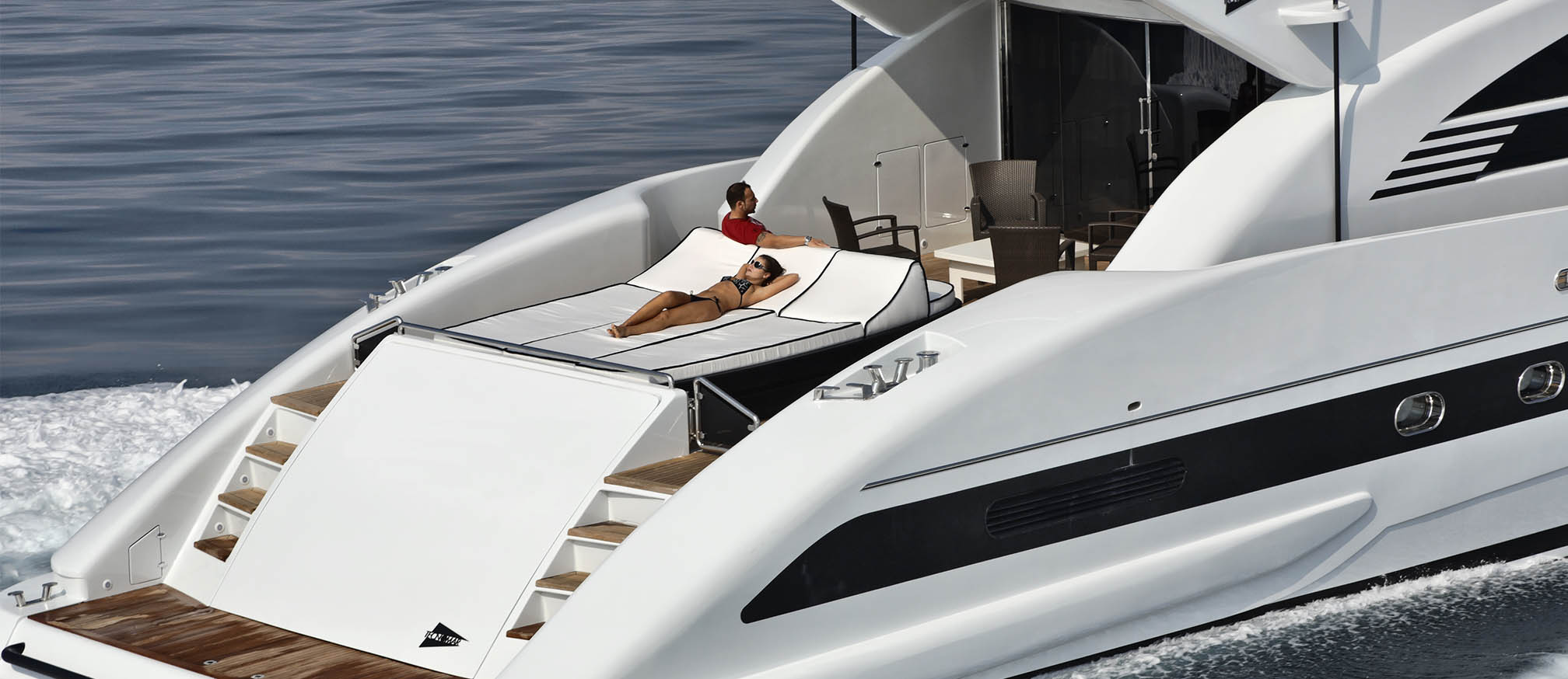 Wife and husband relaxing on a charter megayacht